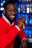 African guy drinking chilled beer — Stock Photo