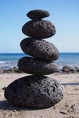 Stack of zen stones near beach — Stock Photo