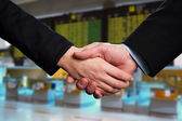 Symbol of agreement, business handshake — Stock Photo