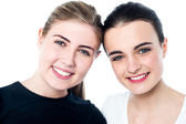 Young smiling girls looking at you — Stock Photo