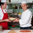 Male chefs in kitchen at work — Stock Photo