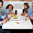 Cheerful family enjoying dinner — Stock Photo