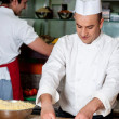 Male chefs working in kitchen — Foto Stock