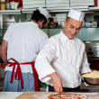 Expert chefs at work inside restaurant kitchen — Foto Stock