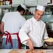 Expert chefs at work inside restaurant kitchen — Stock Photo