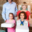 Excited little girls holding pizza boxes — Stock Photo #29204137