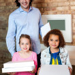 Father with his daughters at pizza outlet — Stock Photo