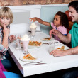 Cheerful family of four enjoying breakfast — Stock Photo #29204165