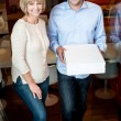 Happy young couple holding pizza boxes — Stock Photo
