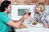 Couple toasting over a restaurant table — Stock Photo
