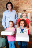 Excited little girls holding pizza boxes — Stock Photo