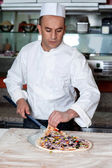 Chef busy in preparing pizza — Stock Photo