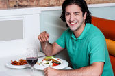 Handsome guy enjoying his meal — Stock Photo