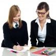 Tutor assisting the student in homework — Stock Photo