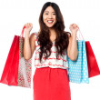 Young shopaholic girl with vibrant bags — Stock Photo