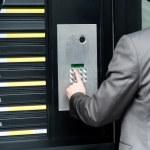 Man entering security code to unlock the door — Stock Photo #29543435
