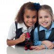 Young little school girls with microscope — Stock Photo
