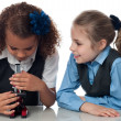 Two pretty school girls with microscope — Stock Photo