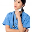 Female surgeon thinking something — Stock Photo