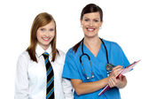 High school girl in doctors clinic — Stock Photo