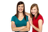 Pretty teenager girl with her mother — Stock Photo