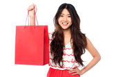 Chinese girl with shopping bag — Stock Photo