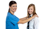 Friendly female doctor with her patient — Stock Photo