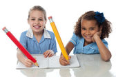 Kids completing their assignment — Stock Photo