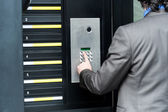 Man entering security code to unlock the door — Stock Photo