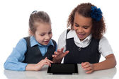 Excited kids using tablet pc — Photo