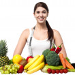 Beautiful young woman with fruits — Foto de Stock