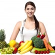 Beautiful young woman with fruits — Foto Stock