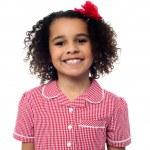 Cute school girl posing in uniform — Stock Photo #29710709