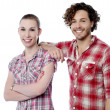 Attractive smiling young couple — Stock Photo