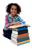 Happy schoolgirl reading a textbook — Stock Photo