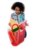 Anxious school girl reading a book — Stock Photo