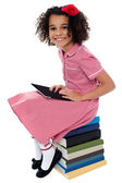 Joyous pretty school kid with tablet pc — Stock Photo