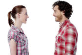 Casual young couple facing each other — Stock Photo