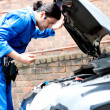 Mechanic checking the motor oil of the car — Photo
