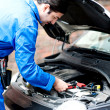 Mechanic repairing car's engine — Stockfoto