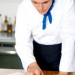Male chef referring to cooking manual — Stock Photo #30752499