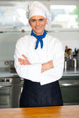 Handsome young chef posing in uniform — Stock Photo