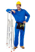 Construction worker with step ladder — Stock Photo