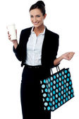 Lady holding coffee cup and shopping bag — Stock Photo