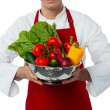 Stock Photo: Male chef holding vegetables bowl