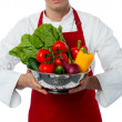 Male chef holding vegetables bowl — Stock Photo #30865055