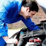Mechanic checking under the car engine — Stock Photo