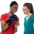 Women viewing pictures in the camera — Stock Photo #32569337