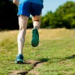 Young fit man running outdoors — Stock Photo