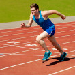 Male runner on starting blocks — Stock Photo